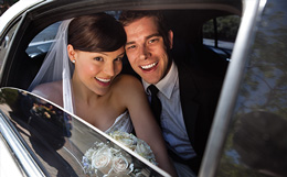 couple inside limo at wedding